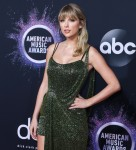 Taylor Swift arrives at the 2019 American Music Awards wearing a Julien Macdonald dress