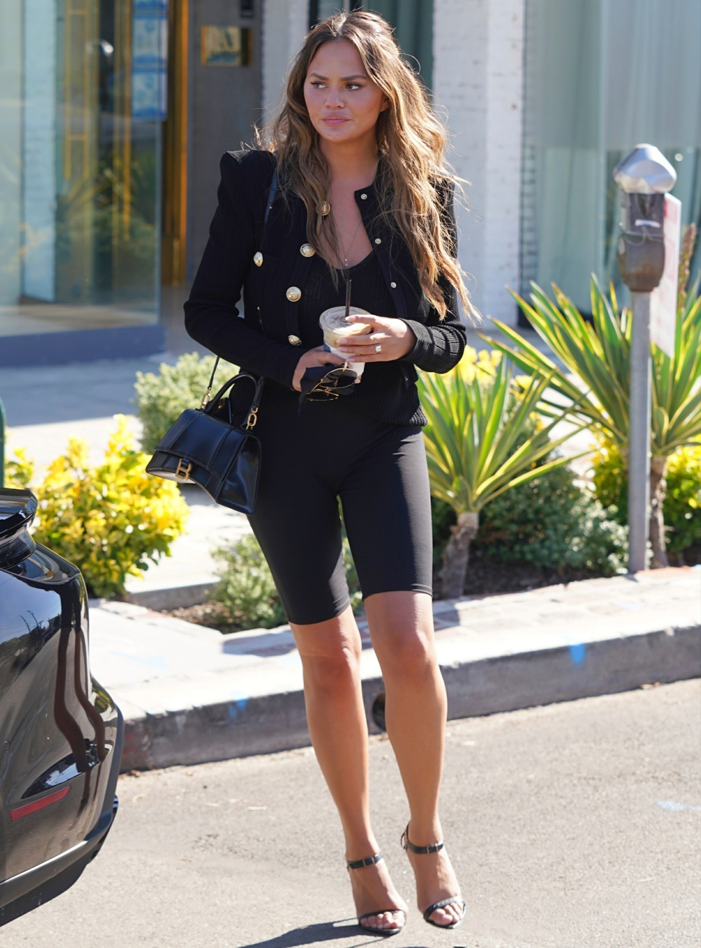 Pregnant Chrissy Teigen goes shopping on Melrose Place
