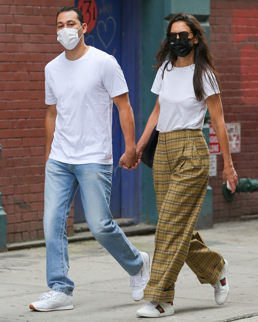 Lovebirds Katie Holmes and Emilio Vitolo Jr hold hands strolling the streets of New York
