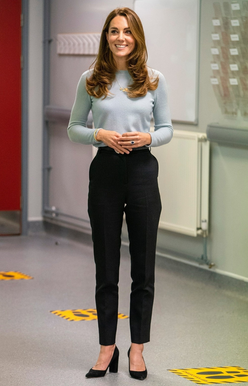 The Duchess of Cambridge wears a face mask as she visits students at the University of Derby