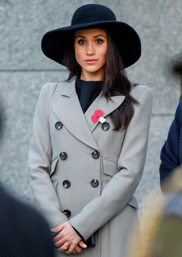 Meghan Markle, the US fiancee of Britain's Prince Harry, attends an Anzac Day dawn service at Hyde Park Corner in London on April 25, 2018.  Anzac Day commemorates Australian and New Zealand casualties and veterans of conflicts and marks the anniversary of the landings in the Dardanelles on April 25, 1915 that would signal the start of the Gallipoli Campaign during the First World War.