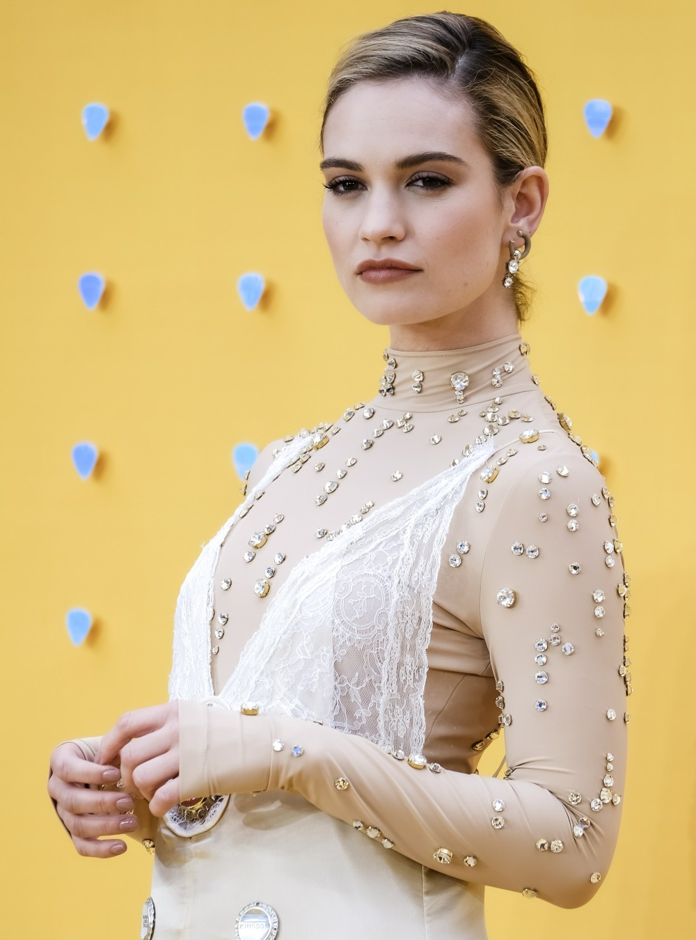 Lily James poses on the red carpet for the UK premiere of YESTERDAY