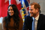 Britain's Prince Harry, Duke of Sussex and Meghan, Duchess of Sussex gesture during their visit to Canada House in thanks for the warm Canadian hospitality and support they received during their recent stay in Canada,  in London on January 7, 2020.