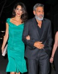 Amal Clooney and George Clooney walk arm-in-arm after a law benefit in NYC