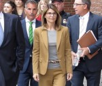 Lori Loughlin and husband exiting Boston Courthouse **FILE PHOTOS**