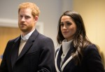 Britain's Prince Harry (L) and his fiancee US actress Meghan Markle (R) visit Nechells Wellbeing Centre to join Coach Core apprentices taking part in a training masterclass in Birmingham, central England on March 8, 2018. 