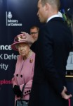 Britain's Queen Elizabeth II (L) looks on as Britain's Prince William, Duke of Cambridge (R) asks a question about forensics work as they visit the Energetics Analysis Centre as they visit the Defence Science and Technology Laboratory (Dstl) at Porton Down science park near Salisbury, southern England, on October 15, 2020. - The Queen and the Duke of Cambridge visited the Defence Science and Technology Laboratory (Dstl) where they were to view displays of weaponry and tactics used in counter intelligence, a demonstration of a Forensic Explosives Investigation and meet staff who were involved in the Salisbury Novichok incident. Her Majesty and His Royal Highness also formally opened the new Energetics Analysis Centre.