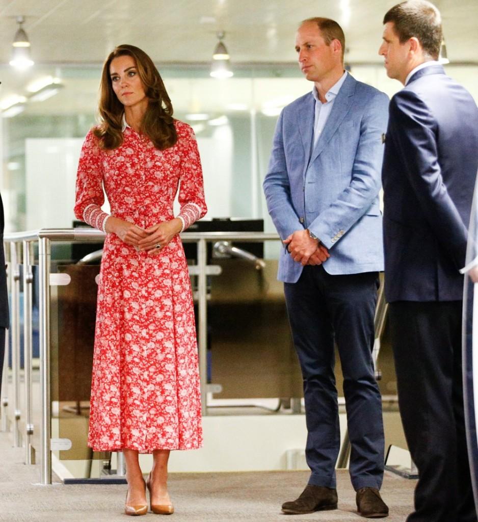 Britain's Prince William and Catherine, Duchess of Cambridge speak to staff at the London Bridge Jobcentre, in London