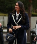 Meghan Markle, together with Britain's Prince Harry, arrives in Birmingham