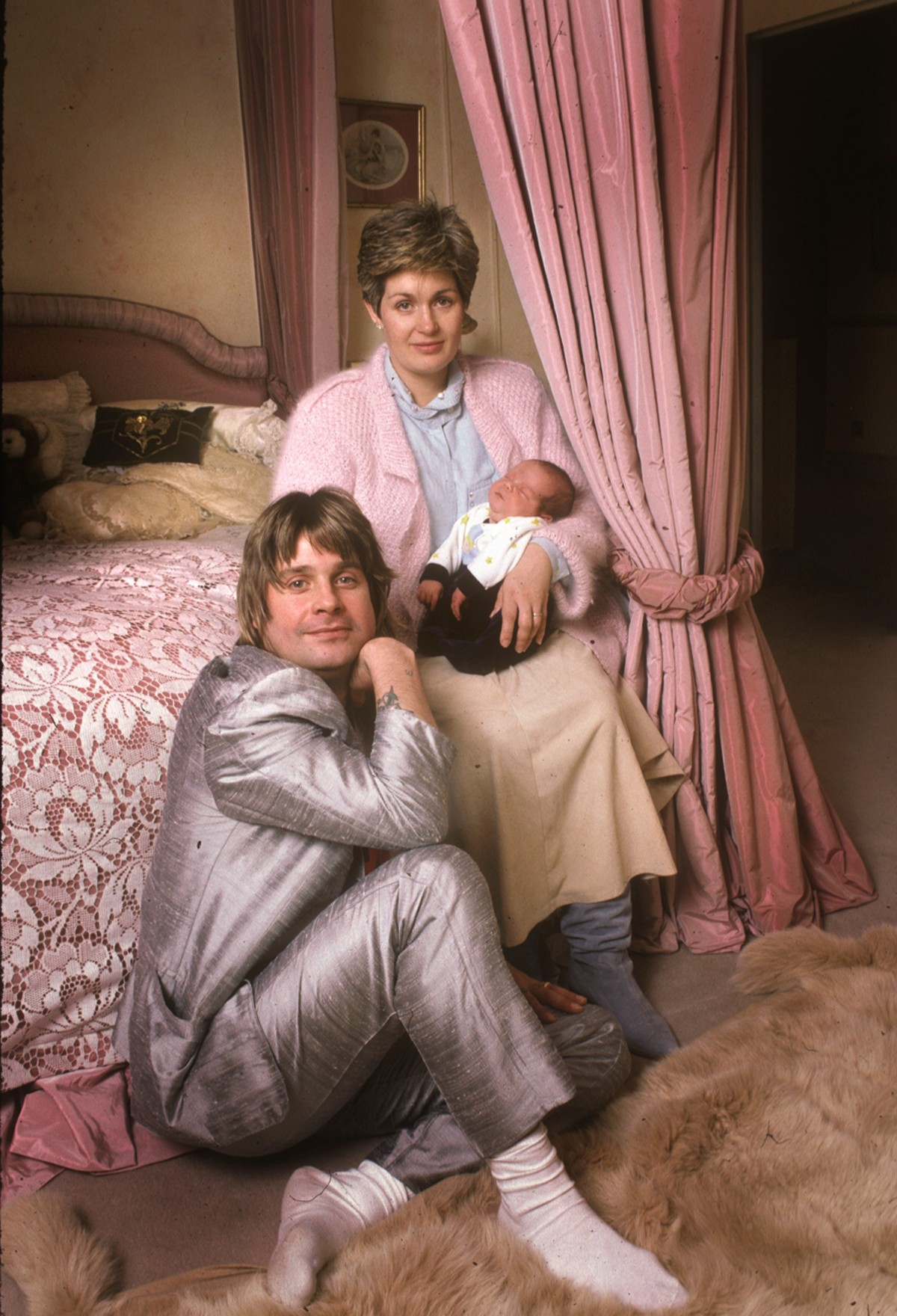 Ozzy Osbourne with Sharon and Baby Jack At their Home Hampstead . London . 1985