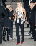 Miley Cyrus is flanked by security leaving the Marc Jacobs fashion show