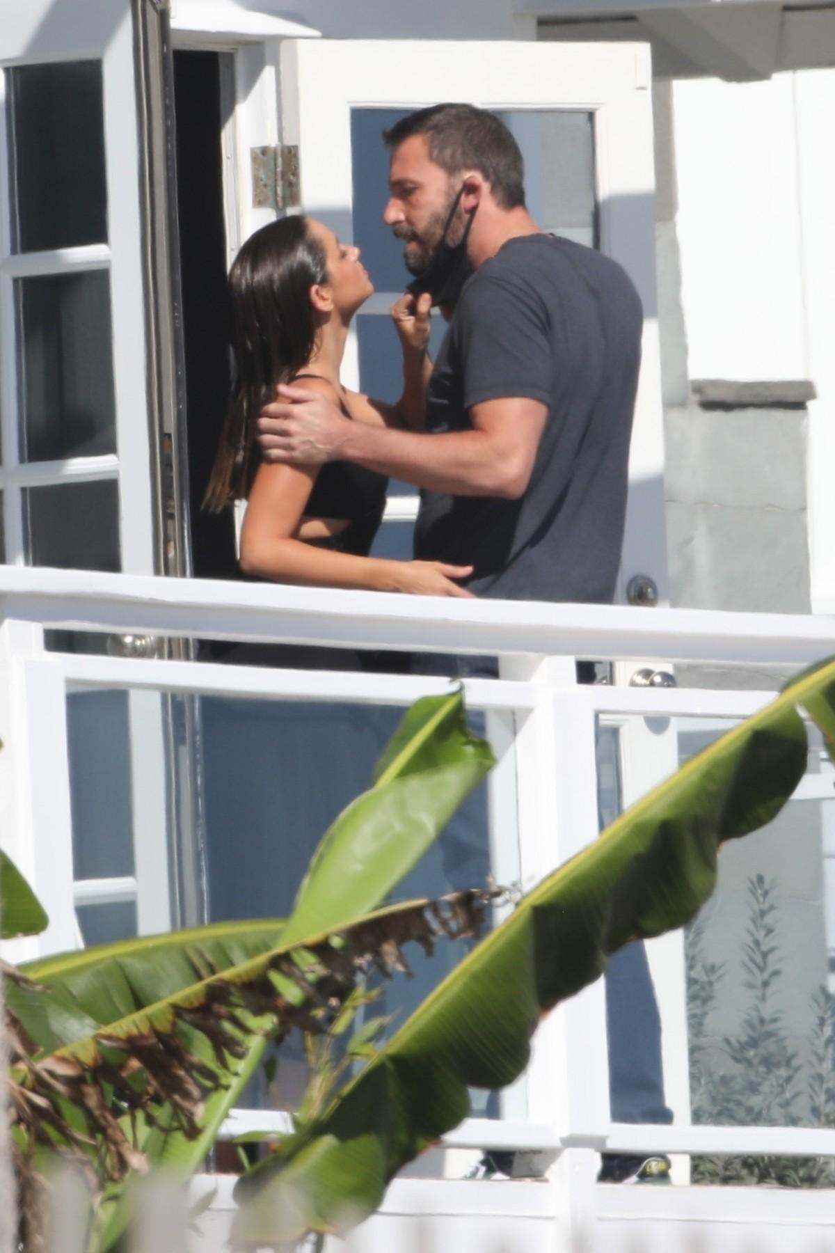 Ben Affleck's girlfriend Ana de Armas pulls down his mask for a kiss at a beach photoshoot