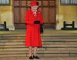 Britain's Queen Elizabeth II reacts as she waits to thank local volunteers and k