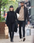 Emma Stone and boyfriend Dave McCary have their hands full with shopping bags and laundry