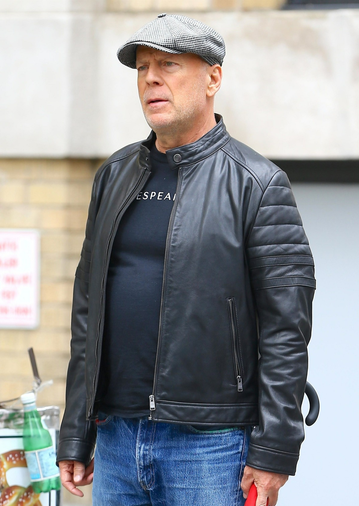 Bruce Willis cuts a casual figure in black leather jacket for outing in New York City