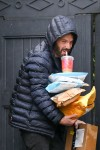 Ben Affleck grabs packages that were delivered to his house while sipping his coffee