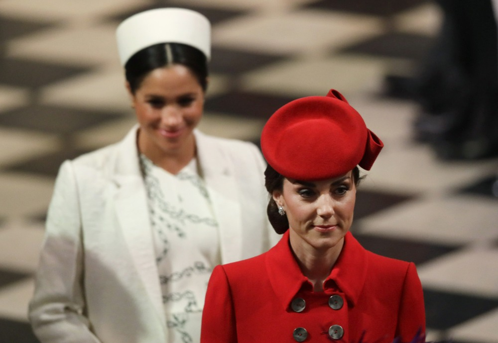 Britain's Kate, Duchess of Cambridge, and Meghan, the Duchess of Sussex leave af