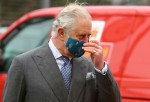 Britain's Prince Charles, Prince of Wales, wearing a mask because of the coronav