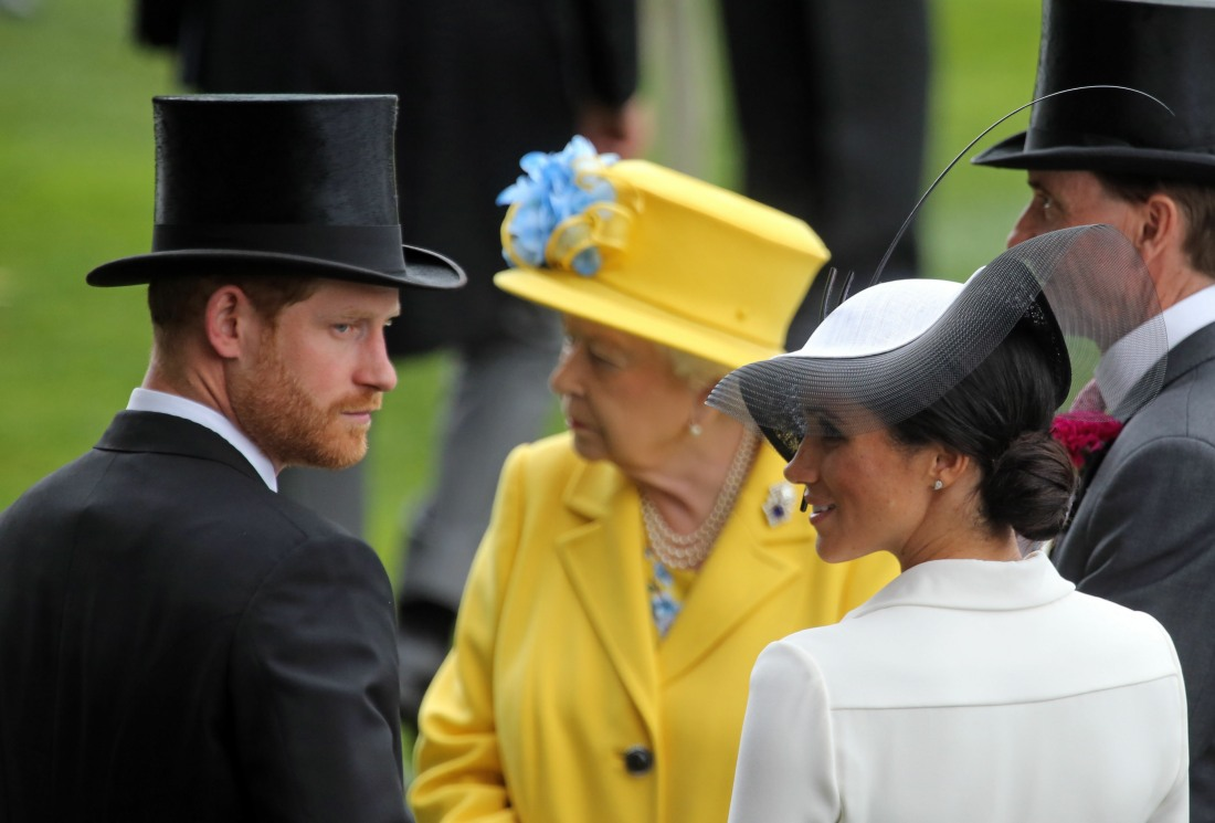 Royal Ascot, Portrait of TRH Prince Harry, the Duke of Sussex and TRH Meghan the Duchess of Sussex in front of HRH Queen Elizabeth the Second