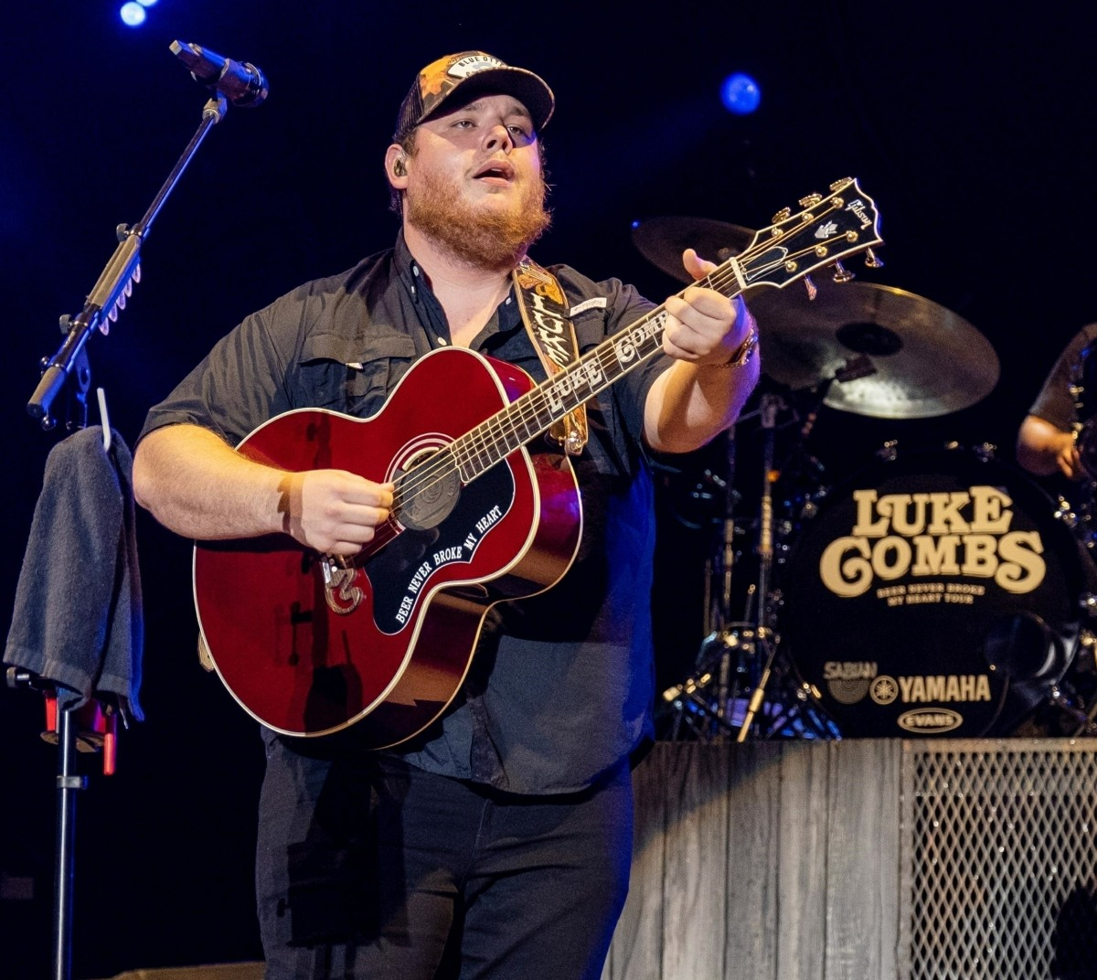 Luke Combs performing live at the Country Thunder Music Festival