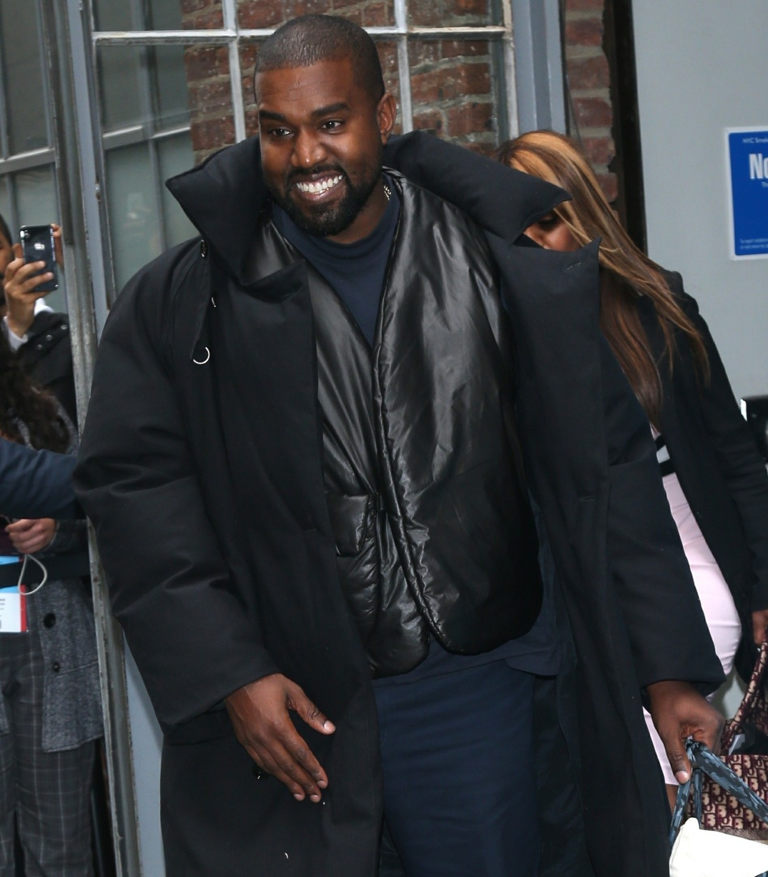 Kanye West smiles bright leaving Fast Company's Innovation Festival in NYC