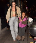 Kim Kardashian arrives at the Kanye West after party with daughter North West and sister Kourtney Kardashian