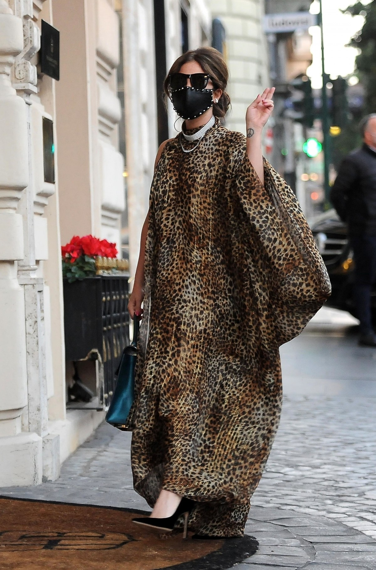 Lady Gaga looks every inch a glamourous pop star wearing her animal-printed kaftan out in Rome