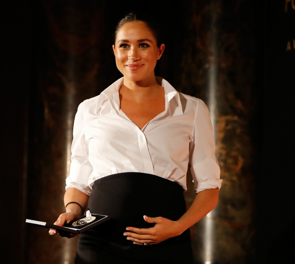 Britain's Meghan, Duchess of Sussex presents the Celebrating Excellence Award to Nathan Forster, a former soldier of the Army's Parachute Regiment, at the annual Endeavour Fund Awards at Draper's Hall in London on February 7, 2019. - The Royal Foundation's Endeavour Fund Awards celebrate the achievements of wounded, injured and sick servicemen and women who have taken part in sporting and adventure challenges over the last year. Forster suffered serious injuries whilst serving with the Parachute Regiment in Afghanistan. With Flying for Freedom Nathan discovered a passion and aptitude for flying and in only five years, he has gone from having no experience of flying, to flying 737's for Thomas Cook.