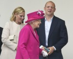 Zara and Mike Tindall leave with Britain's Queen Elizabeth after they attended the Patron's Lunch on the Mall, an event to mark the queen's 90th birthday, in London
