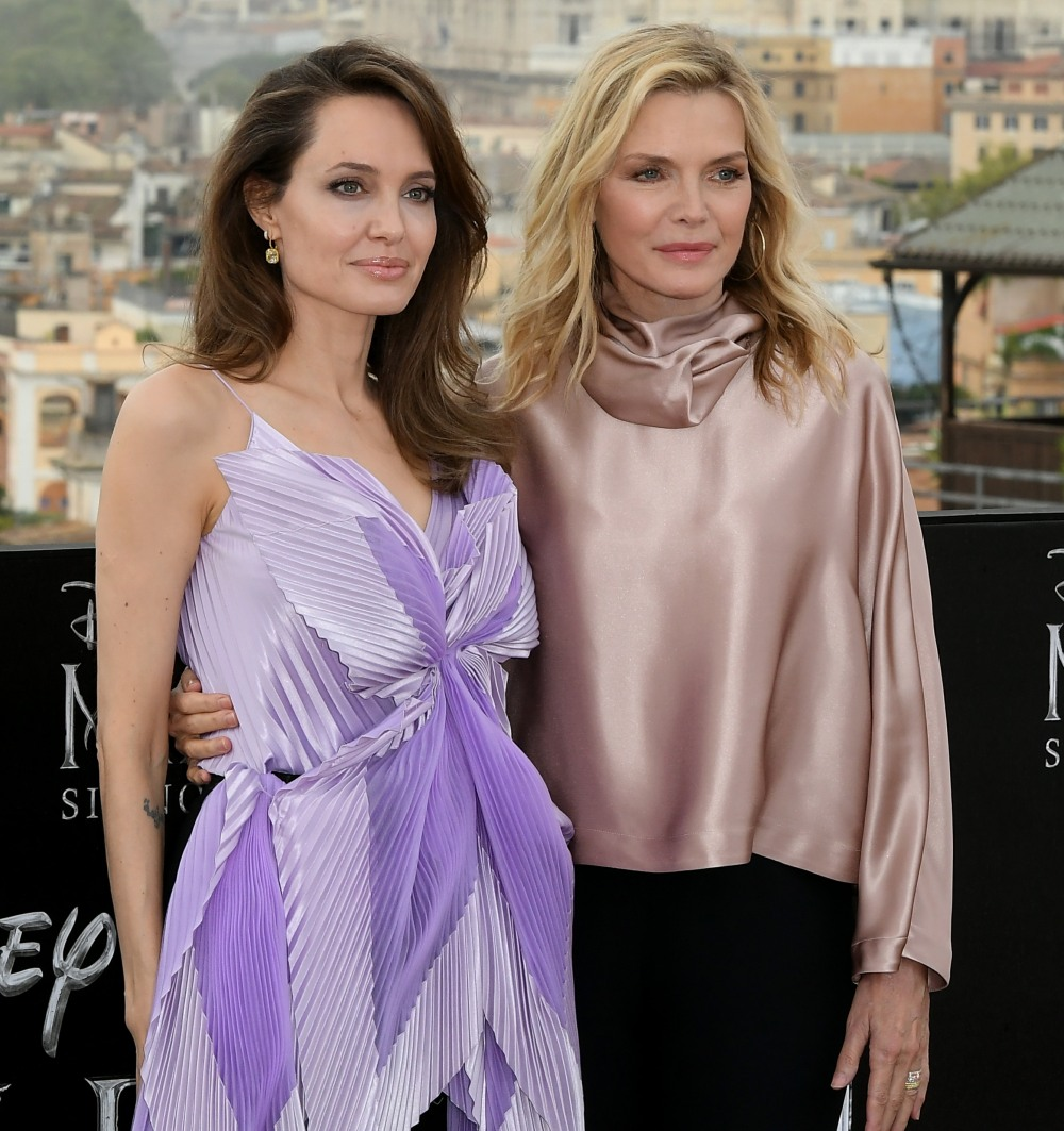 Angelina Jolie, left, and Michelle Pfeiffer pose during the photo call for the European premiere of the movie Maleficent: Mistress of Evil, in Rome, Italy 07-10-2019