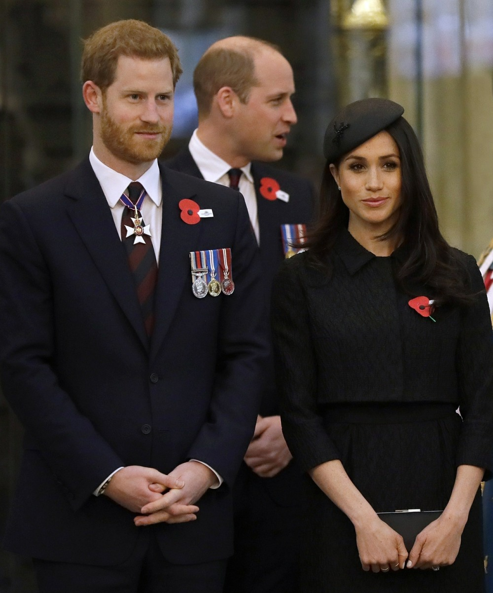 Prince William, Prince Harry and Meghan Markle attend an Anzac Day Service