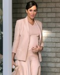 Pregnant Meghan Markle shows off her baby bump at the National Theatre in London