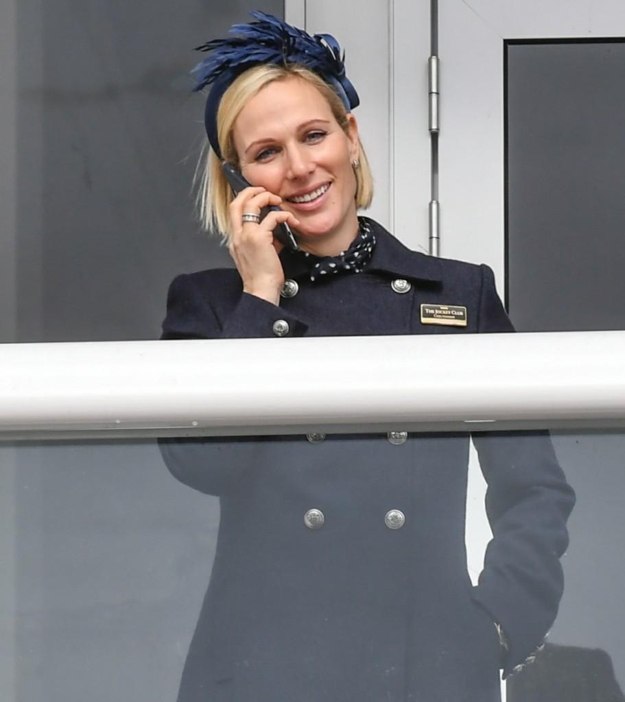 Zara Tindall uses her mobile phone whilst enjoying  day one of The Festival, Cheltenham Racecourse, Prestbury, Cheltenham, Glos