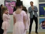 Britain's Prince Harry, Duke of Sussex (R) joins children taking part in ballet class for 4 to 6 year olds, while on a visit to YMCA South Ealing in west London on April 3, 2019, to learn more about their work on mental health and see how they are providing support to young people in the area - YMCA South Ealing is part of 'YMCA St Paul's Group', which provides services across South West, South and East London, and is one of the largest YMCAs in Europe. The South Ealing association primarily provides supported housing, providing somewhere to live for 150 young people who are having to deal with issues such as homelessness, mental illness, are recovering from substance misuse, or are fleeing domestic violence.