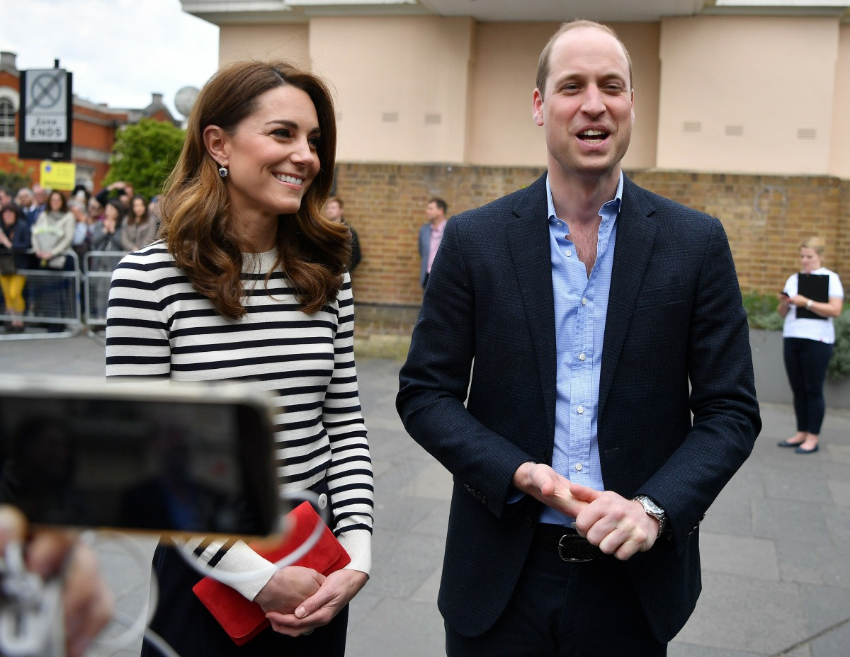 Britain's Catherine, Duchess of Cambridge (L) and Britain's Prince William, Duke of Cambridge talk to members of the media about their newborn nephew, as they arrive to launch the King's Cup Regatta, at the Cutty Sark in Greenwich, south east London on May 7, 2019. - The event is set to take place on August 9, 2019, on the Isle of Wight, and is set to see The Duke and Duchess go head to head as skippers of individual sailing boats, in an eight boat regatta race. Each boat taking part will represent one of eight charities and the winning team will be awarded the historic trophy The King's Cup.
