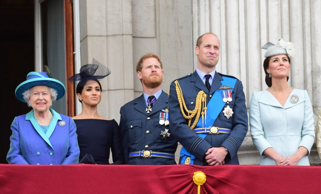 From left, Queen Elizabeth II, Meghan Duchess of Sussex, Prince Harry Duke of Sussex, Prince William Duke of Cambridge and Katherine Duchess of Cambridge watch the RAF 100th anniversary flypast from the balcony of Buckingham Palace, London, Tuesday 10th J