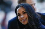 Britain's Prince Harry's fiancee US actress Meghan Markle is greeted as they arrive to attend a Terrence Higgins Trust World AIDS Day charity fair at Nottingham Contemporary in Nottingham, central England, on December 1, 2017.  Prince Harry and Meghan Ma