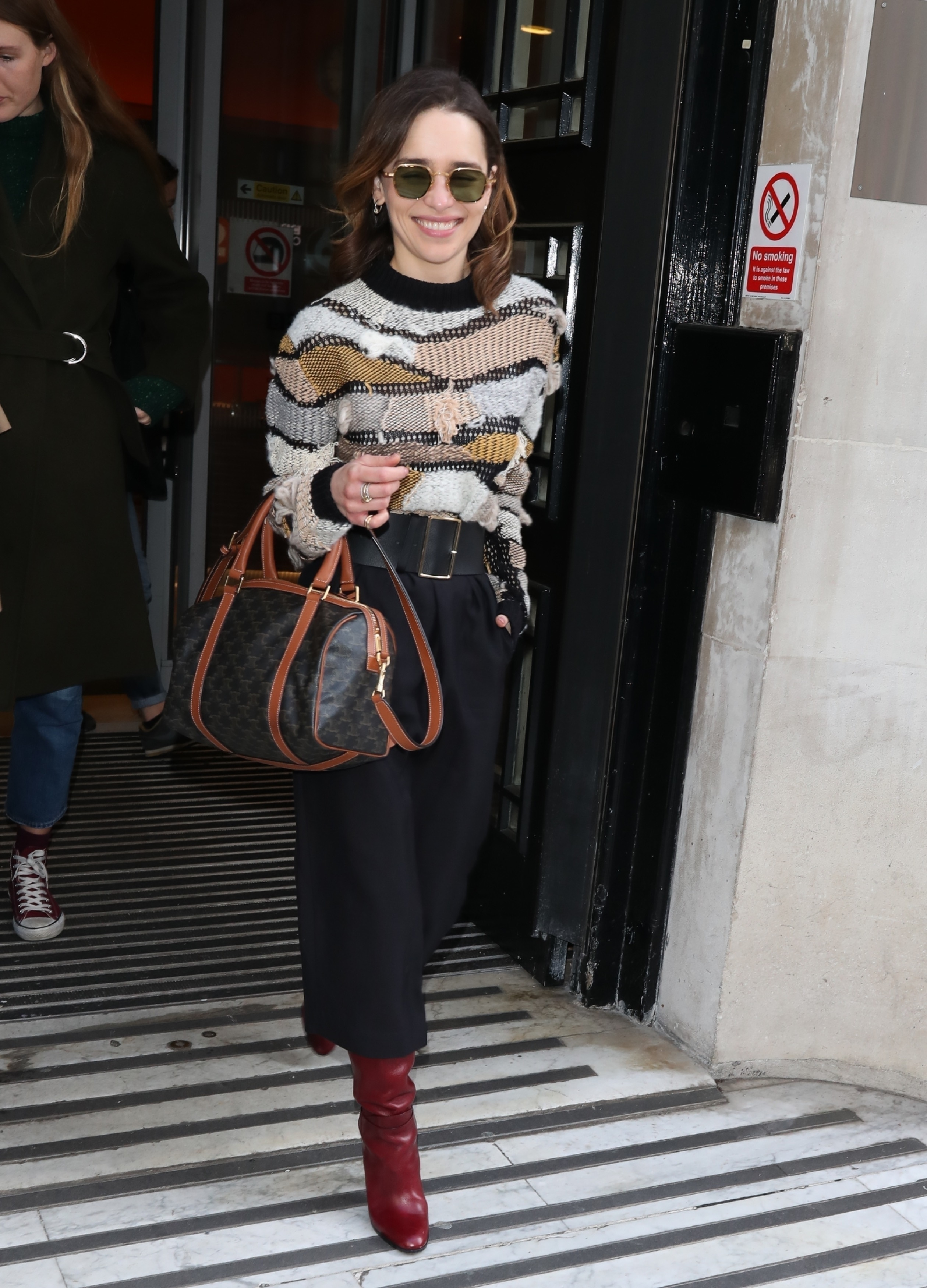 Emilia Clarke is stylish in a multicolored wool top while leaving the Zoe Ball breakfast show