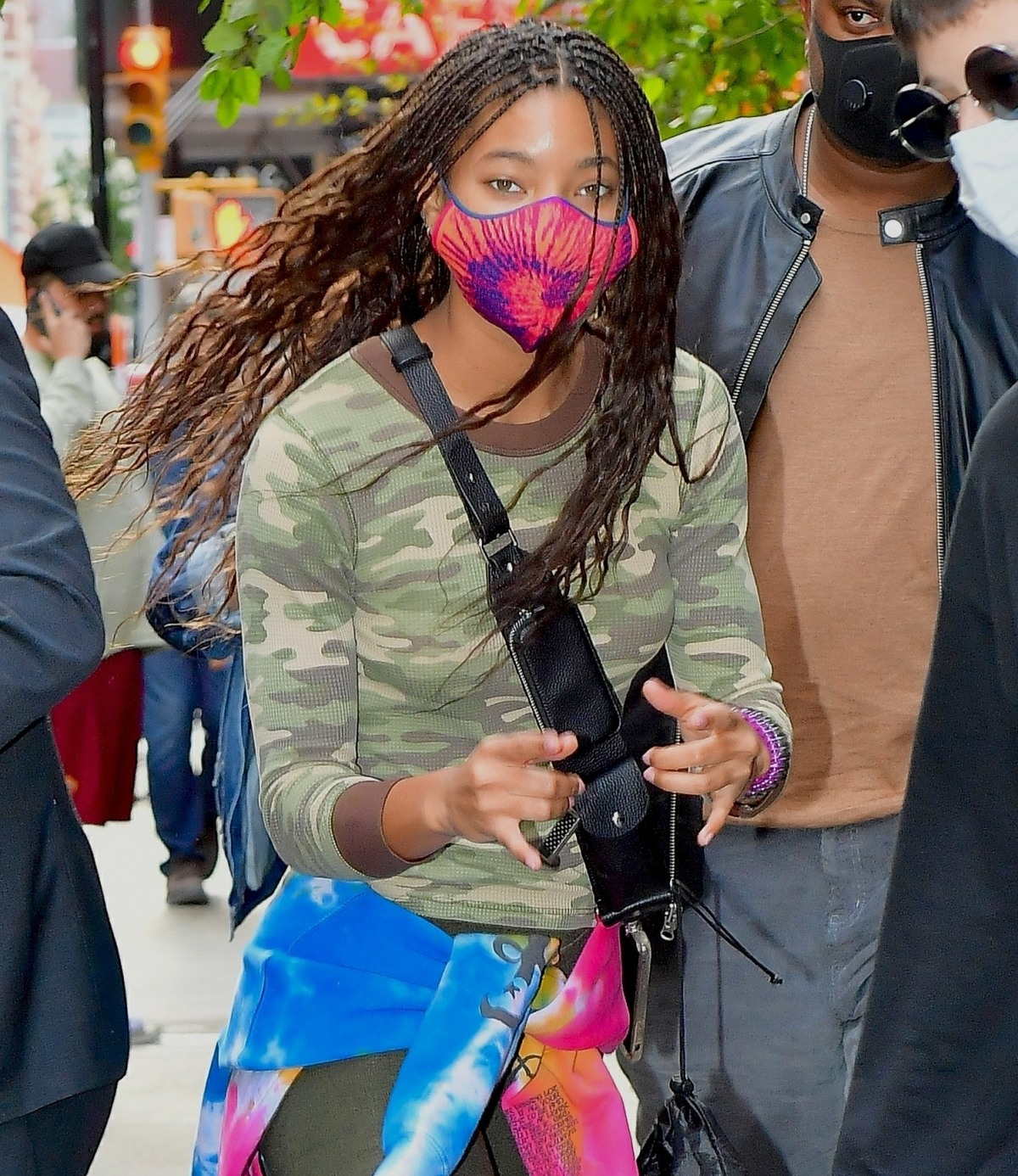 Willow Smith shows peace signs as she steps out in funky fashion for lunch in NYC