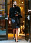 Rosie Huntington-Whiteley heads out in NYC in a black leather skirt and fuzzy sweater