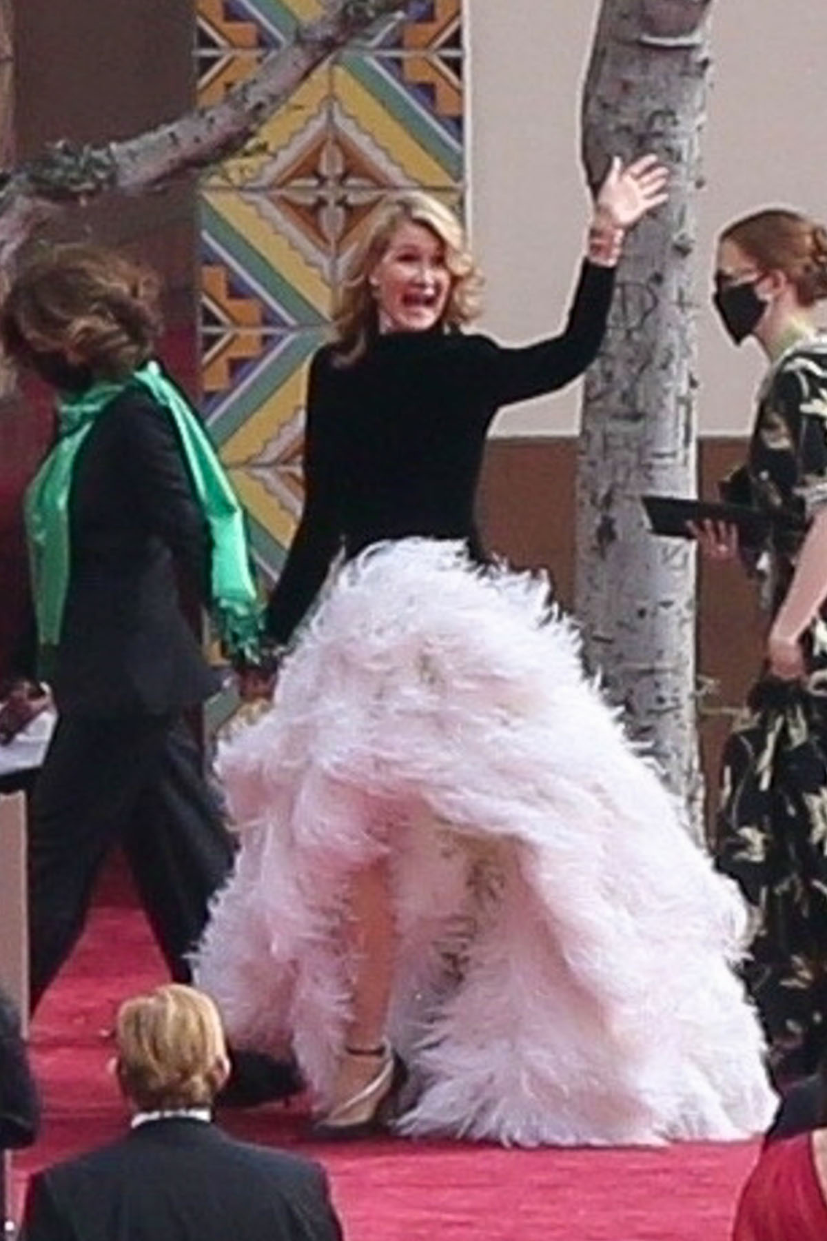 Laura Dern waves on the red carpet at the 93rd Annual Academy Awards