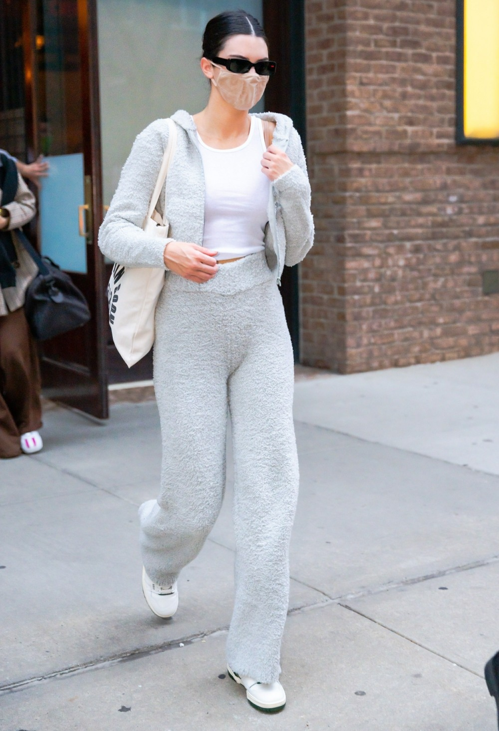 Kendall Jenner wears Alo yoga after she checks out of her hotel in New York City