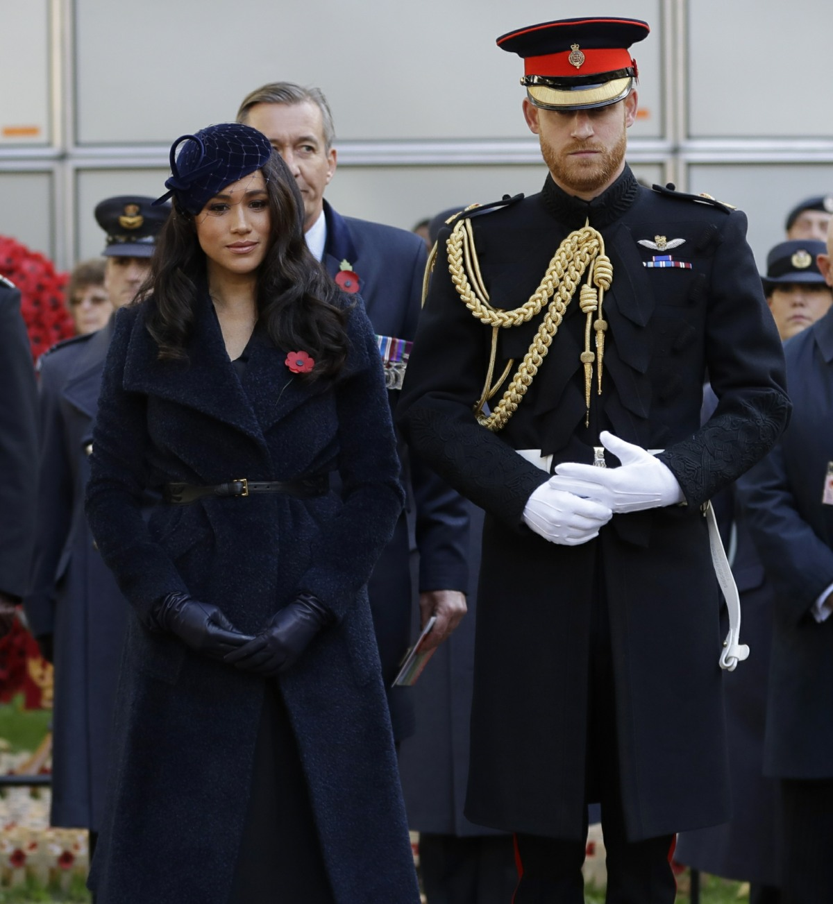 Britain's Prince Harry and Meghan, the Duchess of Sussex attend the 91st Field of Remembrance at Westminster Abbey in London, Thursday, Nov. 7, 2019.