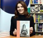 Nigella Lawson signs her book