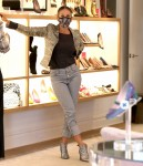 """Sarah Jessica Parker attends to costumers at the """"SJP By Sarah Jessica Parker"""" store at the Seaport District, Manhattan"""