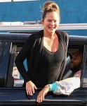 John Legend and Chrissy Teigen drive through Biden's parade in West Hollywood, CA