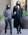 Angelina Jolie holds hands with her daughter Zahara while out shopping