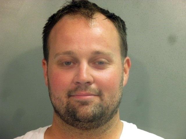 Josh Duggar appears to smirk for his arrest photo