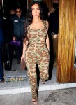 Kim Kardashian turns heads in a camo jumpsuit while leaving Kendall Jenner's 818 tequila launch party