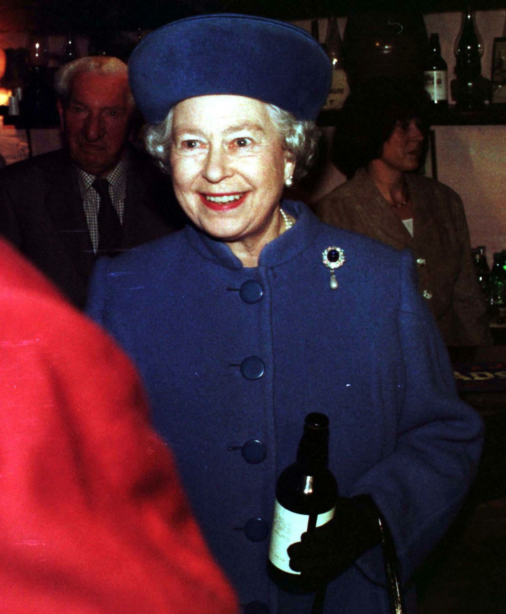 *NB: NO UK USE*HM QUEEN ELIZABETH IIHolding a bottle of beer which was presented to her by the proprietor of the Bridge Inn, Topsham, Devon during her visit.Bandphoto Agency PhotoB68 052338   27.03.199880